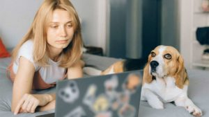 Woman at computer with dog
